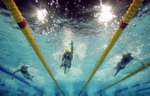 ATHENS - AUGUST 14:  Lisbeth Lenton of Australia in action in  the women's 4 x 100 metre freestyle relay final on August 14, 2004 during the Athens 2004 Summer Olympic Games at the Main Pool of the Olympic Sports Complex Aquatic Centre in Athens, Greece. (Photo by Adam Pretty/Getty Images)